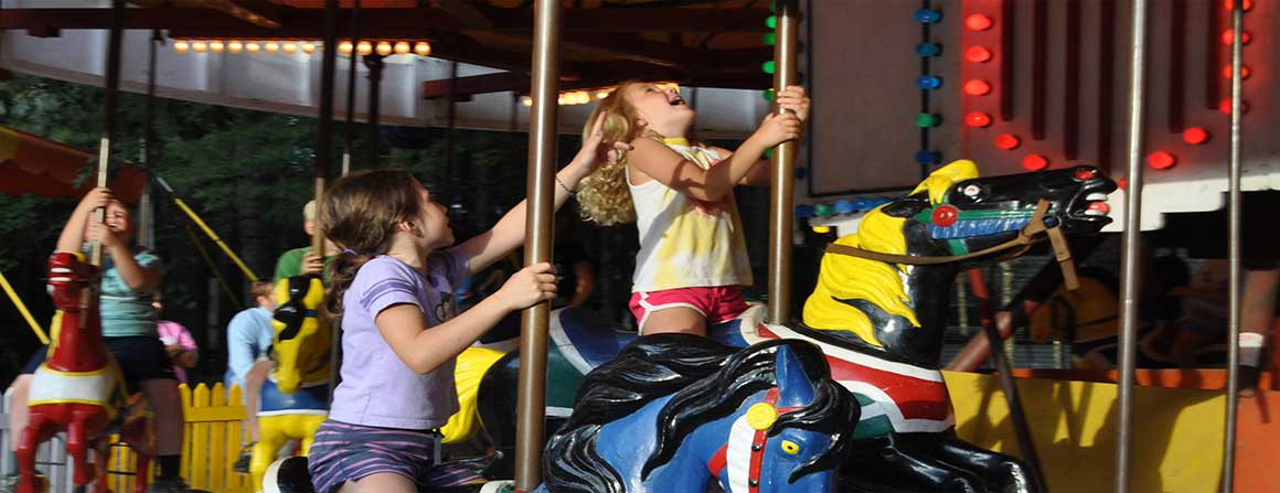 Kids enjoying the Papoose Pond Campground carousel