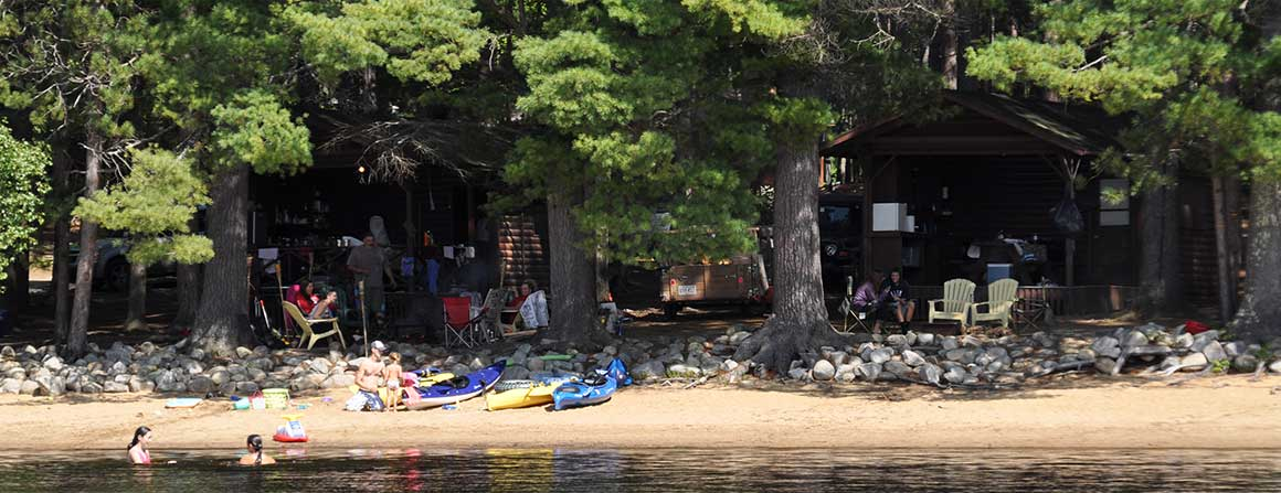 Wooded campsites right on the beach at Papoose Pond Camp